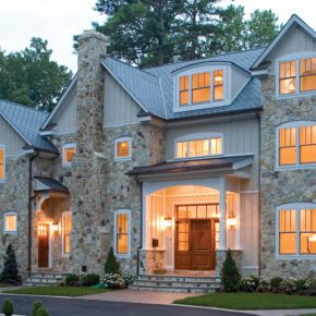 front view of stone home with new glass windows