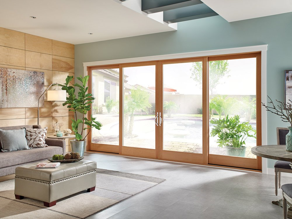 double wide sliding glass doors opening from living room to back yard
