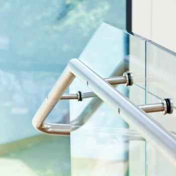 Custom handrail with glass side wall