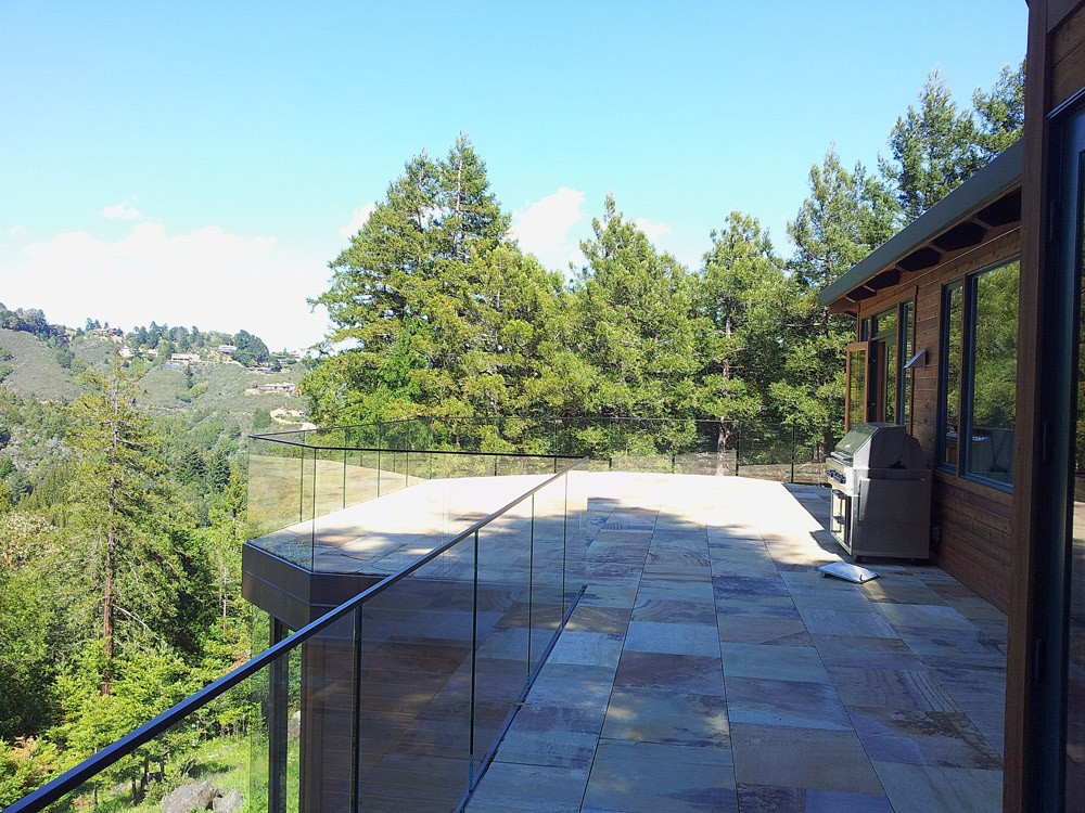 view from residential second floor patio with glass hand rails