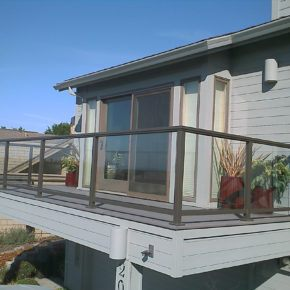 rear deck on residential home with glass handrails