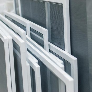 A variety of custom sized window and door screens