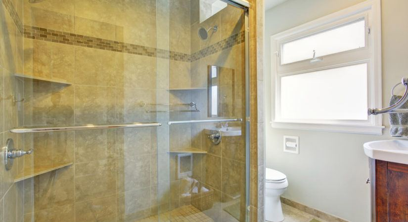 Sliding glass shower door.